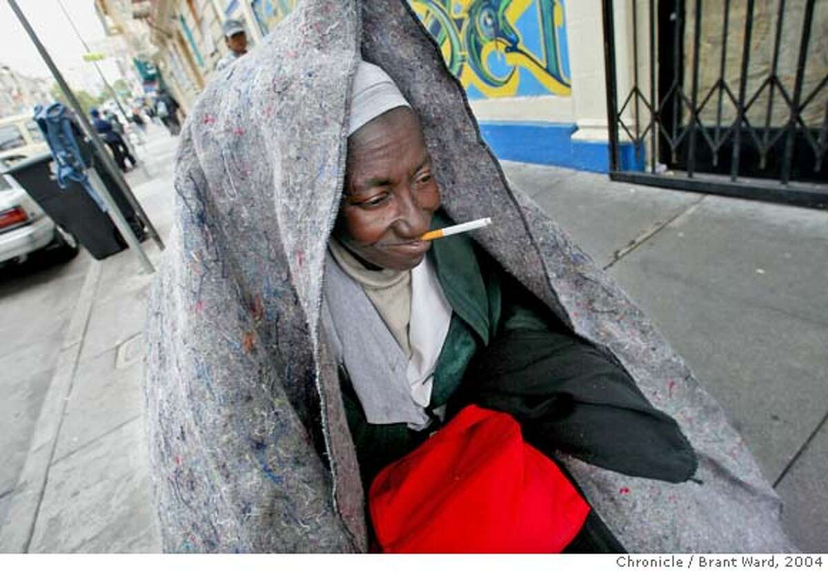 On the streets, Georgia could often be seen with a blanket for warmth and a cigarette in her mouth...here she tools around the Tenderloin. Georgia Mitchell, a homeless woman, has lived in San Francisco for years. In recent years, a medical problem with her knee has caused her to require a wheelchair. In 2005, when the pain became unbearable she began a long medical journey, got SSI benefits, and a room inside thanks to the Care Not Cash program. In the process the city has spent hundreds of thousands of dollars to help this one homeless woman. Brant Ward6/3/04