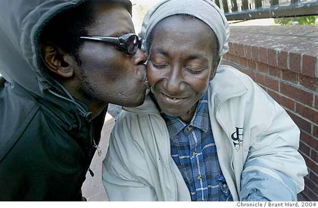 "She is affectionately called ""Mama"" by many in the Tenderloin...here she gets a kiss from an unidentified friend on Eddy Street.  Georgia Mitchell, a homeless woman, has lived in San Francisco for years. In recent years, a medical problem with her knee has caused her to require a wheelchair. In 2005, when the pain became unbearable she began a long medical journey, got SSI benefits, and a room inside thanks to the Care Not Cash program. In the process the city has spent hundreds of thousands of dollars to help this one homeless woman. Brant Ward5/30/04 Photo: Brant Ward"