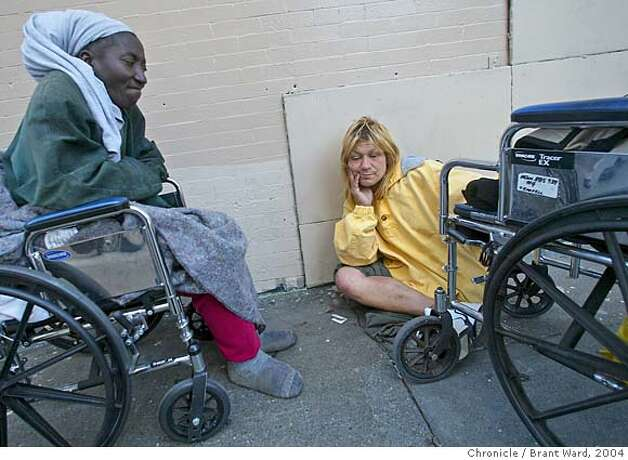 Vina, right, who was in the December 2003 story about a homeless island, stops to visit with Georgia, left, a homeless woman on Leavenworth Street. Both women are confined to wheelchairs.  Brant Ward 6/7/04 Photo: Brant Ward