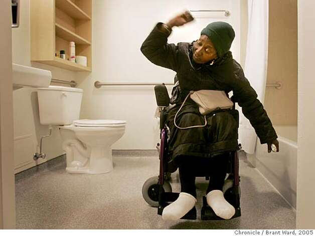 georgia145.jpg  Georgia celebrates her large, wheelchair access bathroom in her new home on Sixth Street.  Georgia Mitchell, a homeless woman, has lived on San Francisco streets for years. In the last few years a medical condition with her knee finally forced her to seek treatment. Through a series of life events she has gotten medical treatment, and gotten permanent housing. It has been a long process costing the city of San Francisco over a quarter of a million dollars.  {Brant Ward/The Chronicle} 12/21/05 Photo: Brant Ward