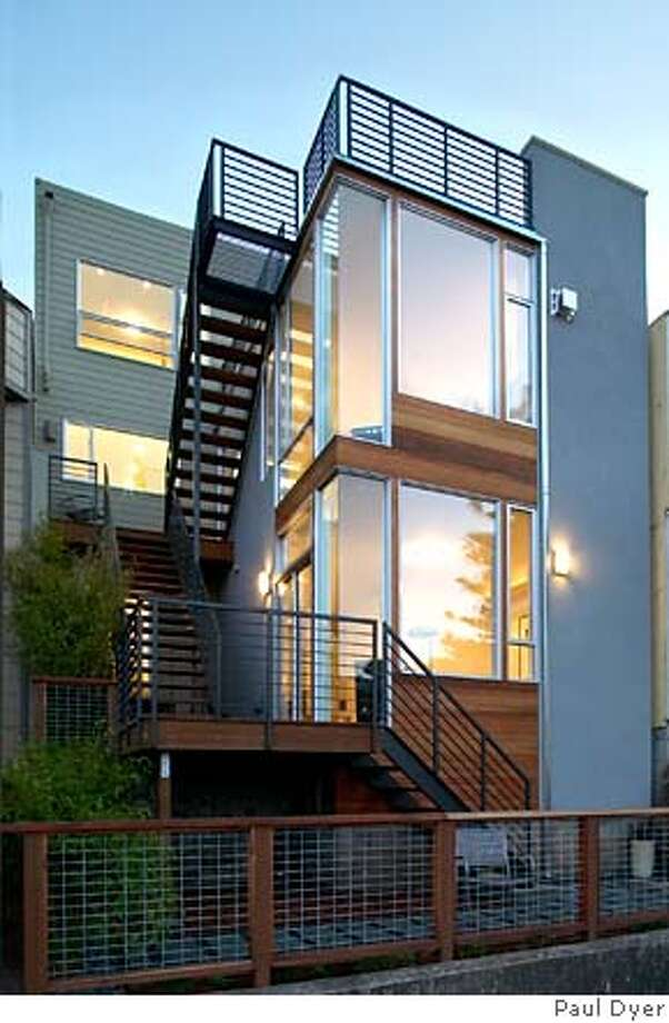 The rear elevation of 576 30th St., San Francisco, showcasing two-story addition with lots of glass. House was gutted and rebuilt by architect Ross Levy and put on the market for $2.195 million. Photo: Paul Dyer