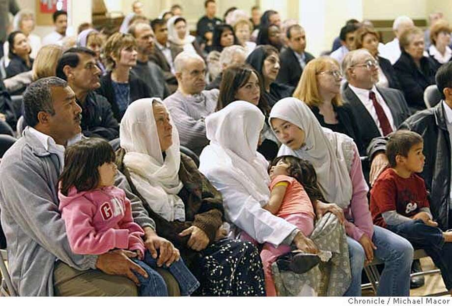 fremont29_075_mac.jpg The Ansari family including the husband of Alia, Ahmadullah Asari, (left) along with 3 of his 6 children pictured, listen to the service. Public memorial service, at Centerville Presbyterian Church, for Alia Ansari, the Fremont mother of 6, gunned down last week as she walked to pick up two of her children from school. The service called , Bridge building, made an effort to create a better understanding between Christians and MUslins, over 100 people attended the gathering. Event in, Fremont, Ca, on 10/28/06. Photo by: Michael Macor/ San Francisco Chronicle Mandatory credit for Photographer and San Francisco Chronicle / Magazines Out Photo: Michael Macor