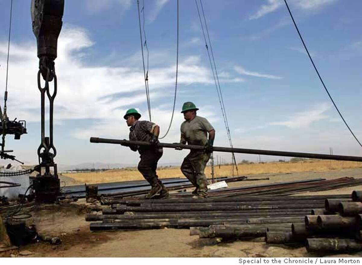 Carlos Sandoval (left) and Jose Rivera work on completing a new well in the oil fields of Coalinga, CA. California is America's fourth-largest oil producing state. Prop 87, which would put a new tax on oil production, could affect the state's oil industry, particularly smaller independent producers.