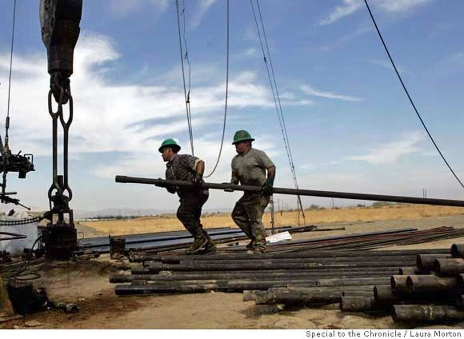 Carlos Sandoval (left) and Jose Rivera work on completing a new well in the oil fields of Coalinga, CA. California is America's fourth-largest oil producing state. Prop 87, which would put a new tax on oil production, could affect the state's oil industry, particularly smaller independent producers. Photo: Laura Morton