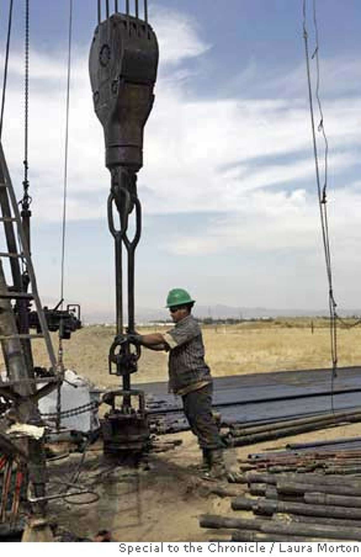 Carlos Sandoval works on completing a new well in the oil fields of Coalinga, CA. California is America's fourth-largest oil producing state. Prop 87, which would put a new tax on oil production, could affect the state's oil industry, particularly smaller independent producers.