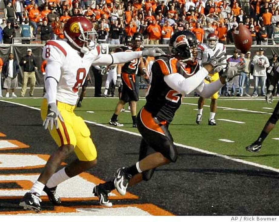 Oregon State's Bryan Payton intercepts the ball in the end zone in front of Southern California's Dwayne Jarrett (8) in the first quarter of their college game Saturday, Oct. 28, 2006, in Corvallis, Ore. (AP Photo/Rick Bowmer) Photo: RICK BOWMER