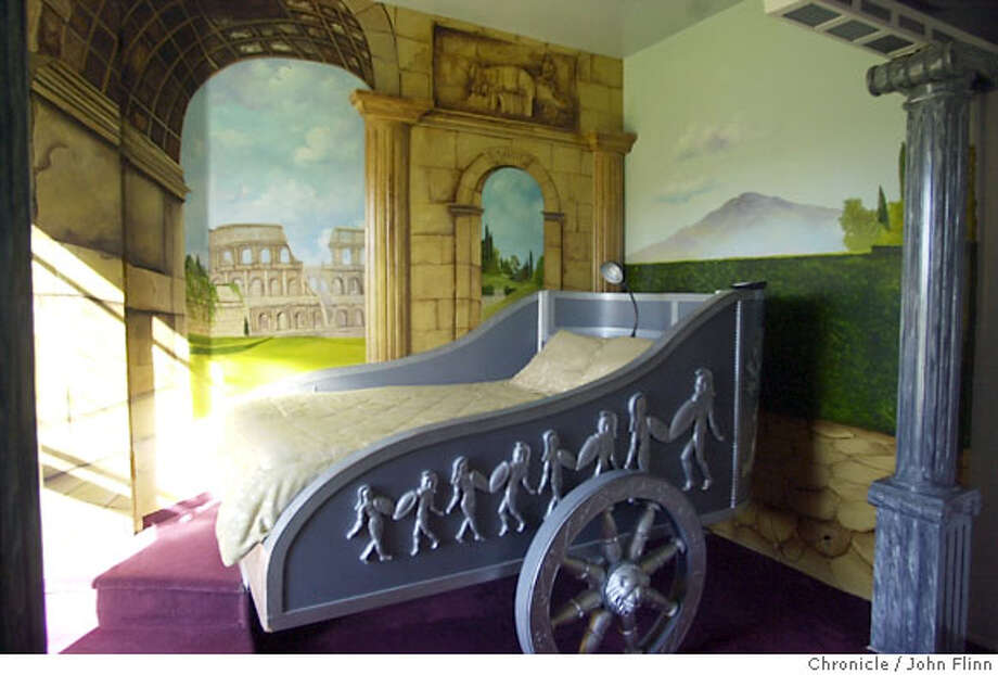 TRAVEL LOS ALAMOS -- In the Roman room at the Victorian Mansion, your bed is a chariot. Photo: John Flinn