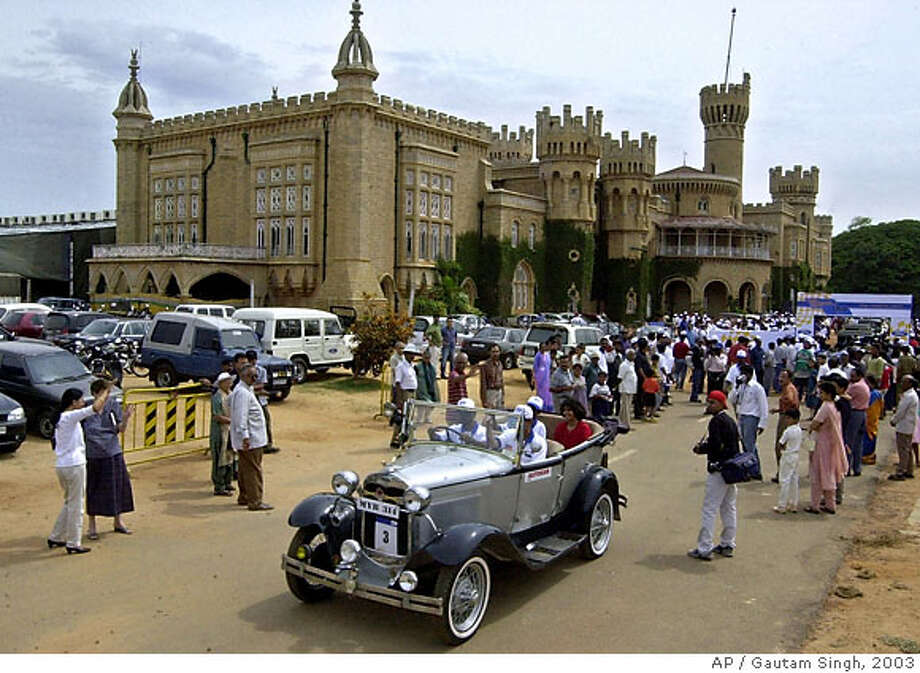 "TRAVEL -- A Ford model ""A Tourer"", of 1928 vintage, starts off from Bangalore Palace, background, as part of the Ford Centenary Celebration Rally in Bangalore, India, Sunday, June 29, 2003. Over 30 classic and vintage Ford cars participated in the rally, which was routed through Bangalore city. (AP Photo/Gautam Singh)  Ran on: 10-29-2006  Next of kin will be notified of the results: Perhaps &quo;Caution: Traffic Lights Changed&quo; would be a bit more effective. Though it is nice to know that in London you're getting run over by a car for a greater cause. Submit your unintentionally funny sign photos to www.signspotting.com. (Do not send them to The Chronicle.) If we use one, you will receive $50 plus the chance to win an around-the-world ticket. Photo: GAUTAM SINGH"