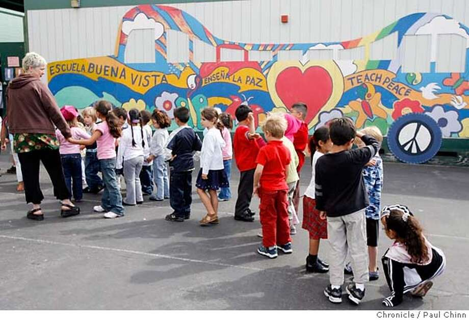 Students form a line to head back to class in front of a portable classroom at Buena Vista Elementary School in San Francisco, Calif. on Thursday, September 14, 2006 where supporters of the Proposition A school bond measure kicked off the campaign. If passed by voters in November, the bond will provide $450 million to rebuild up to 64 school sites which would include replacing portables like the ones at Buena Vista.  PAUL CHINN/The Chronicle MANDATORY CREDIT FOR PHOTOGRAPHER AND S.F. CHRONICLE/ - MAGS OUT Photo: PAUL CHINN
