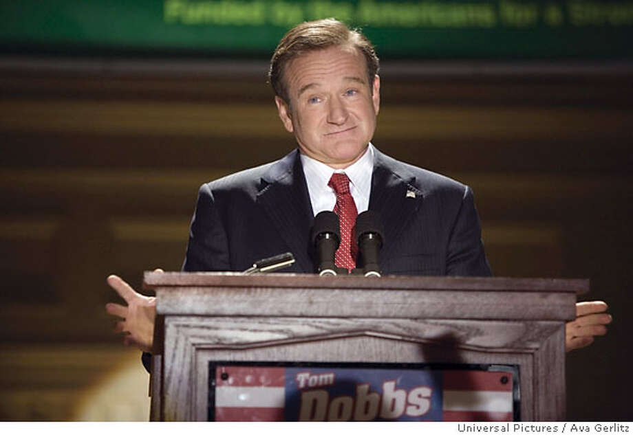 Comedian-turned-candidate Tom Dobbs (ROBIN WILLIAMS) speaks to a star-struck public in the comic tale of an entertainer?s accidental rise to power, ?Man of the Year?. ?Man of the Year? will be released on October 13, 2006.  Ran on: 10-13-2006  Robin Williams as comedian-turned-candidate Tom Dobbs in &quo;Man of the Year.&quo;  Ran on: 10-29-2006  'Man' panned: But new Robin Williams film a big draw. Photo: Photo Credit: Ava Gerlitz / Univ