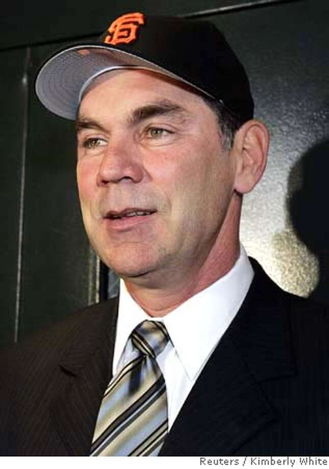 Bruce Bochy wears a San Francisco Giants baseball hat after being introduced as the team's new manager in San Francisco, California October 27, 2006. REUTERS/Kimberly White (UNITED STATES) 0 Photo: KIMBERLY WHITE