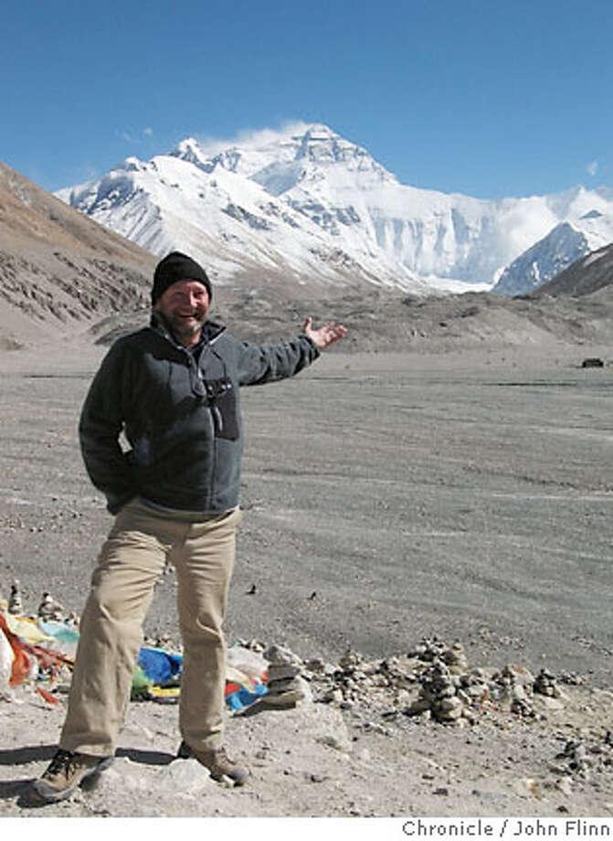 TRAVEL JUST BACK FROM TIBET -- John Flinn at the foot of Mount Everest in Tibet. Photo: John Flinn