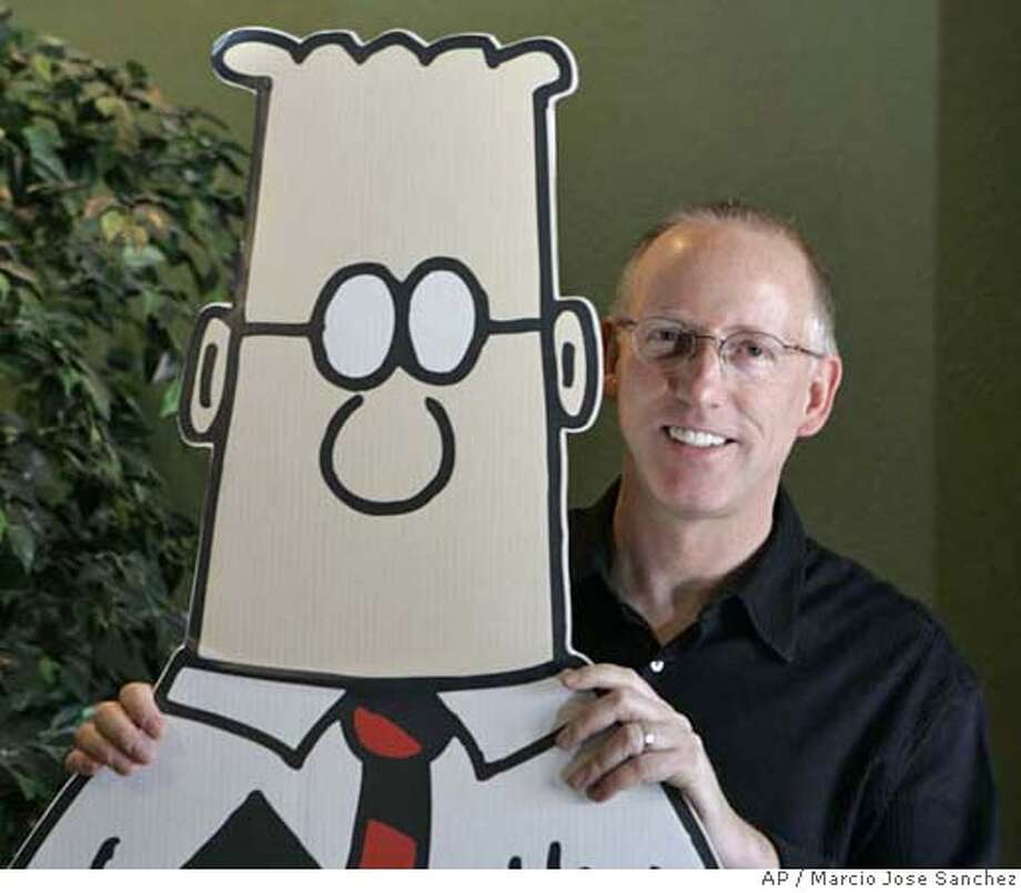 In this file phtoo, Scott Adams, creator of the comic strip Dilbert, poses for a portrait with the Dilbert character in his studio in Dublin, Calif.. Adams, appears to be a rare example of someone who has largely but not totally, recovered from Spasmodic Dysphonia, a mysterious disease in which parts of the brain controlling speech shut down or go haywire. As many as 30,000 Americans are afflicted, typically in their 40s and 50s, experts say. Photo: MARCIO JOSE SANCHEZ
