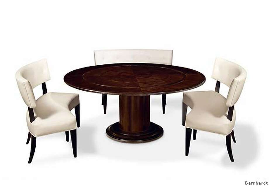 Rounded banquettes for two (or more cozily three) fit Bernhardt's sleek Wilshire Blvd. round dining table. Suggested retail for the table, $1,699; for a banquette, $899. Photo: Handout