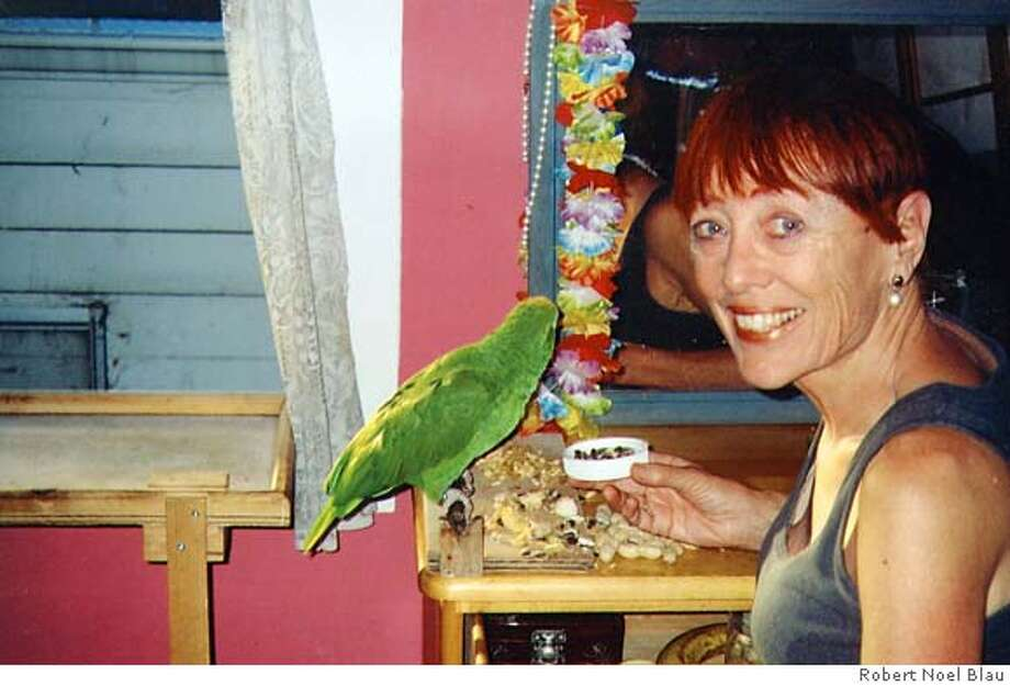 Winnie the parrot likes the peanuts, sunflower seeds, apples and bananas that Marilyn Pon feeds her. Photo by Robert Noel Blau