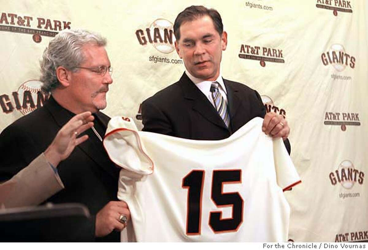 photo by Dino Vournas 10/27/06 for the SF Chronicle Bruce Bochy, right, former San Diego Padres manager, receives his new shirt and number from San Francisco Giants general manager Brian Sabean at a press conference at At&T Park, following his hiring as the club's new manager.