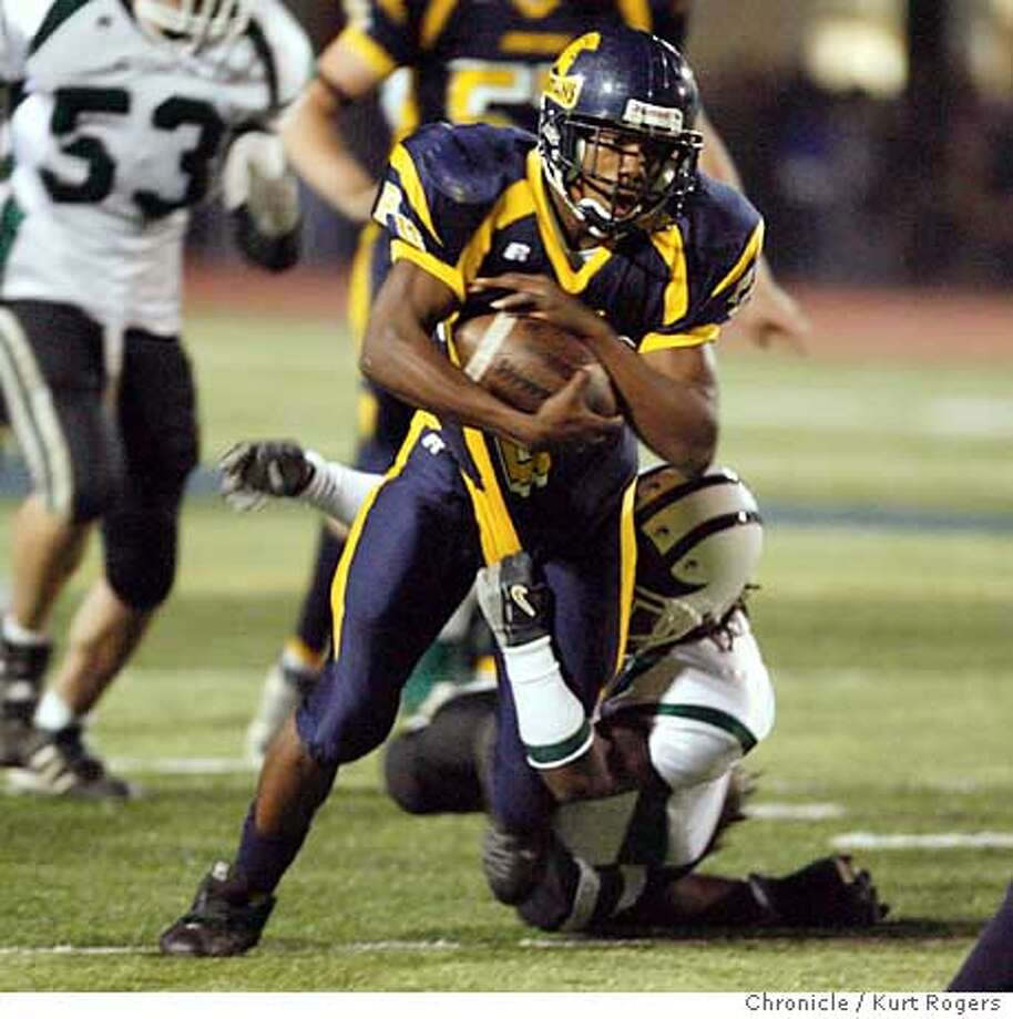 Deante Purvis of Pinole Valley High with this run for a firs down in the first quarter of play.  High school football El Cerrito At Pinole Valley.  KURT ROGERS/THE CHRONICLE PINOLE THE CHRONICLE  SFC PINOLE28_0259_kr.jpg  Ran on: 10-28-2006  Deante Purvis rushed for 221 yards and five touchdowns to lead Pinole Valley's offensive display.  Ran on: 10-28-2006  Deante Purvis rushed for 221 yards and five touchdowns to lead Pinole Valley's offensive display. Photo: KURT ROGERS/THE CHRONICLE