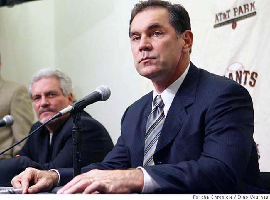 photo by Dino Vournas 10/27/06  for the SF Chronicle  Bruce Bochy, right, former San Diego Padres manager, listens to a question from the media following his hiring as the new manager of the San Francisco Giants. Team general manager Brian Sabean, left, introduced him at a press conference at At&T Park. Photo: Dino Vournas