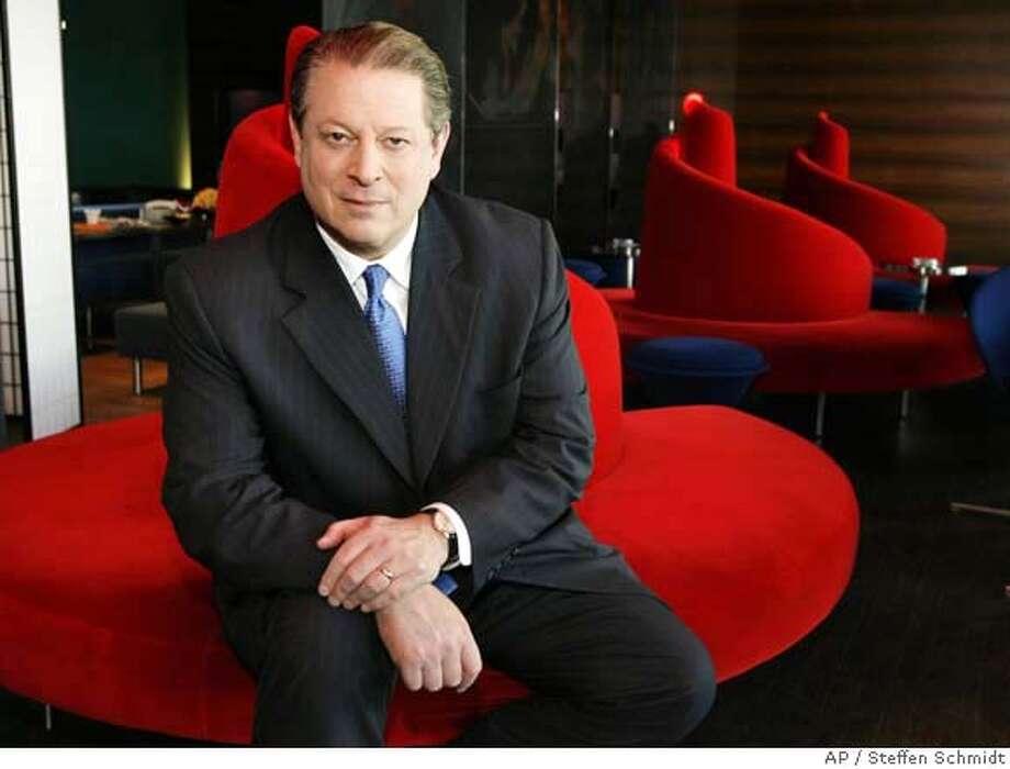 """Former U.S. Vice President Al Gore poses on a sofa in a cinema in Zurich, Switzerland, Saturday, Oct. 7, 2006. Gore is in Zurich to promote the movie """"An Inconvenient Truth"""". (AP Photo/KEYSTONE, Steffen Schmidt) Photo: STEFFEN SCHMIDT"""