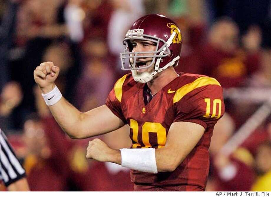 USC quarterback John David Booty celebrates a touchdown during the second half of their game against Arizona State, Saturday, Oct. 14, 2006, in Los Angeles. (AP Photo/Mark J. Terrill) Photo: MARK J. TERRILL
