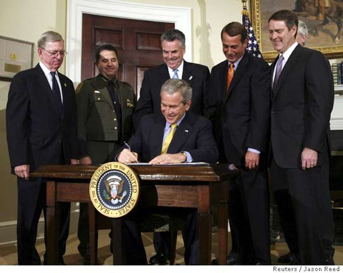 U.S. President George W. Bush signs H.R. 6061, the Secure Fence Act of 2006, in the Roosevelt Room of the White House in Washington October 26, 2006. Bush signed legislation on Thursday to build 700 miles (1,126 km) of fencing along the U.S.-Mexican border, an election-year move against illegal immigration aimed at helping Republicans. REUTERS/Jason Reed (UNITED STATES)