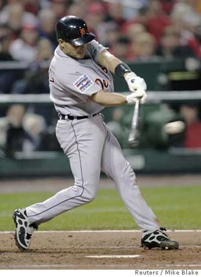 Detroit Tigers Ivan Rodriguez hits an RBI single in the third inning against St. Louis Cardinals in Game 4 in Major League Baseball's World Series in St. Louis, October 26, 2006. REUTERS/Mike Blake (UNITED STATES) 0 Photo: MIKE BLAKE