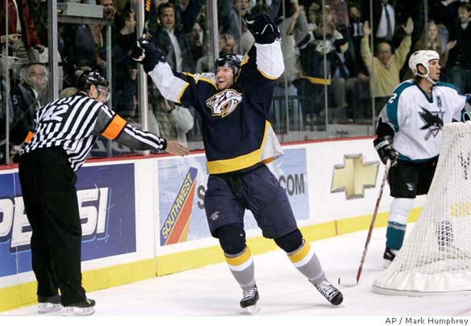 Nashville Predators right wing Scott Hartnell, center, celebrates his game-winning goal in the third period against the San Jose Sharks in an NHL hockey game in Nashville, Tenn., Thursday, Oct. 26, 2006. Referee Dan O'Rourke (42) signals the goal. At right is Sharks defenseman Scott Hannan. (AP Photo/Mark Humphrey) EFE OUT Photo: MARK HUMPHREY