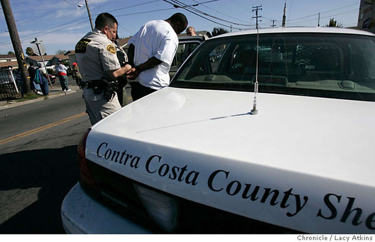 Contra Costa County Sheriffs and FBI serviced sixteen search warrants and arrested approximately nine on state and federal warrants for drugs and gangs while conducted a raid in North Richmond, Ca., Wednesday Oct. 25, 2006. (Lacy Atkins/The Chronicle)