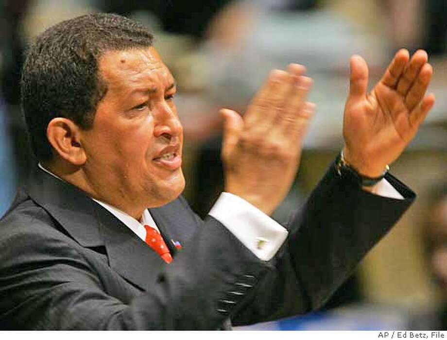 "** FILE ** Hugo Chavez. President of Venezuela, addresses the 61st session of the U.N. General Assembly at UN headquarters, in this Sept. 20, 2006 file photo. Unlike in years past, Bush's address to the General Assembly did not make waves. It was Iran's president, Mahmoud Ahmadinejad, who attracted the rock star treatment and Chavez, who drew applause when he called Bush ""the devil. (AP Photo/Ed Betz, File) Photo: ED BETZ"
