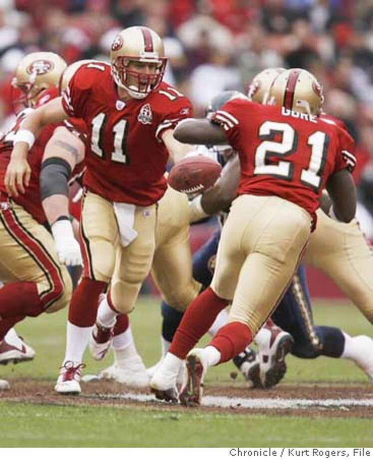 San Francisco 49ers quarterback Alex Smith (11) hands off to running back Frank Gore (21) in the 1st quarter. San Diego Chargers play the San Francisco Niners at Monster Park in San Francisco on Oct. 15, 2006. Kurt Rogers /The Chronicle MANDATORY CREDIT FOR PHOTOG AND SF CHRONICLE/ -MAGS OUT Photo: Kurt Rogers