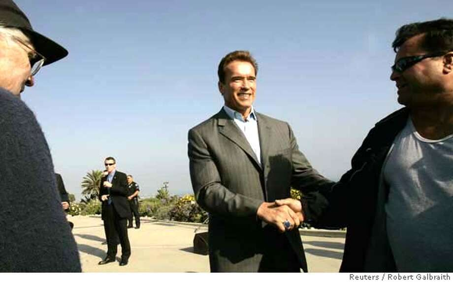 California Governor Arnold Schwarzenegger shakes hands with a supporter during a campaign appearance in San Pedro, California October 25, 2006. Schwarzenegger, who was campaigning for Proposition 84, a ballot measure that will keep the water supply safe and protect the coast line, is running against Democratic challenger Phil Angelides in his reelection bid on November 7. REUTERS/Robert Galbraith (UNITED STATES) 0 Photo: ROBERT GALBRAITH
