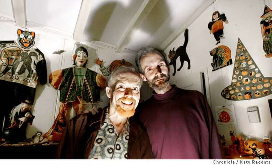 ".jpg  SHOWN: L to R: Carl Linkhart and his partner Larry Schmidt in their tiny house surrounded by the Halloween ephemera they collect. Larry Schmidt began collecting Halloween ephemera years ago, and these days he and his partner Carl Linkhart revel in their ""soft haunt"" for the neighborhood kids outside their unpretentious house in Oakland. These photos were made in Oakland, CA. on Thursday, Oct. 12, 2006 (Katy Raddatz/San Francisco Chronicle)  **Larry Schmidt, Carl Linkhart Mandatory credit for the photographer and the San Francisco Chronicle/ --Mags out Photo: Katy Raddatz"