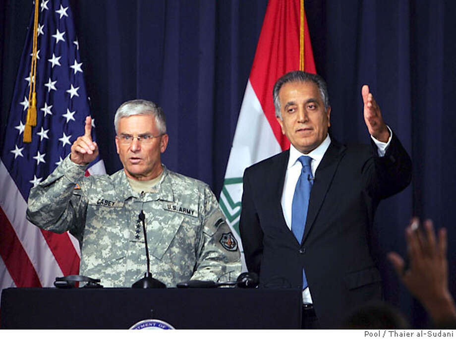 Top U.S. commander in Iraq, General George Casey,left, and U.S. Ambassador to Iraq Zalmay Khalilzad answer questions during a press conference at the heavily fortified Green Zone in Baghdad, Tuesday Oct. 24, 2006. Iraqi forces should be able to take full control of security in the country within the next 12 to 18 months with minimal American support, Gen. George Casey, the top U.S. commander in Iraq, said on Tuesday. (AP Photo/Thaier al-Sudani, Pool) Photo: THAIER AL SUDANI
