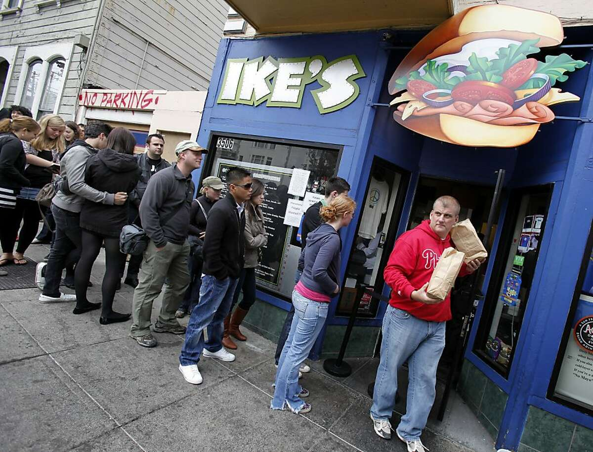 Jeff Brewer (right in red sweatshirt) brought his family to Ike's for a sandwich while on vacation from Florida. They heard about the place on the Food Network. The popular Ike's sandwich store on 16th Street in San Francisco, Calif. is in danger of being shut down because of some recent unresolved legal issues Thursday August 5, 2010.