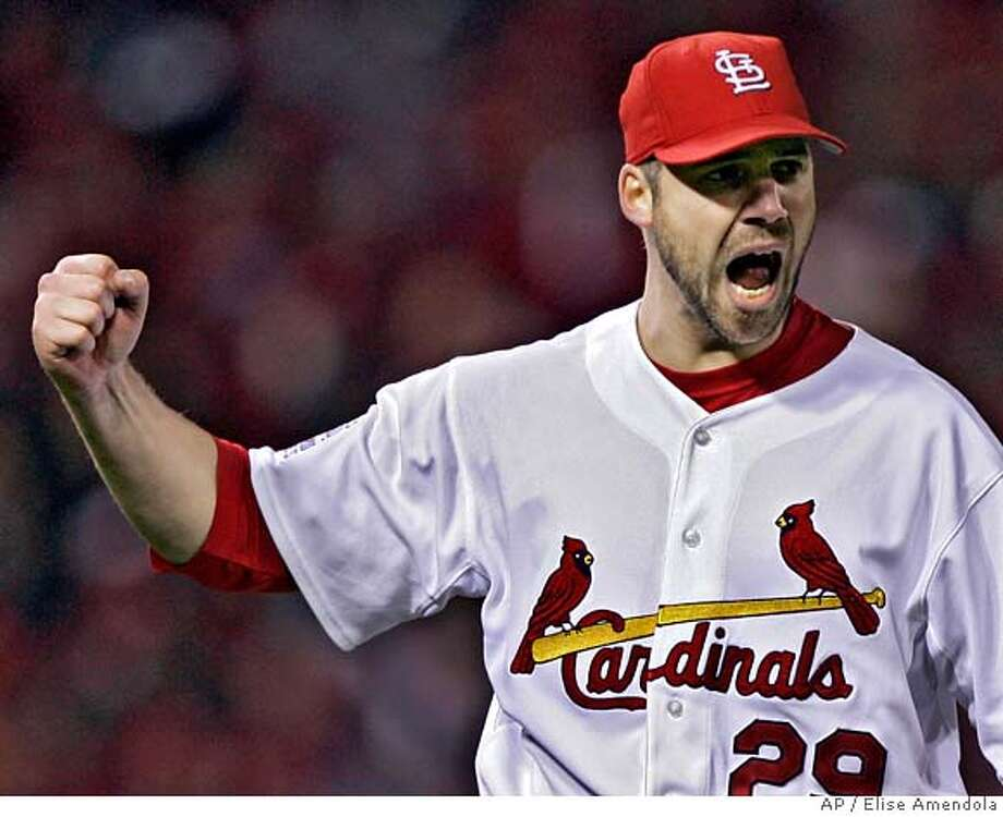 St. Louis Cardinals starting pitcher Chris Carpenter reacts after a double play to end the seventh inning against the Detroit Tigers in Game 3 of the World Series on Tuesday, Oct. 24, 2006 in St. Louis. (AP Photo/Elise Amendola) Photo: Elise Amendola