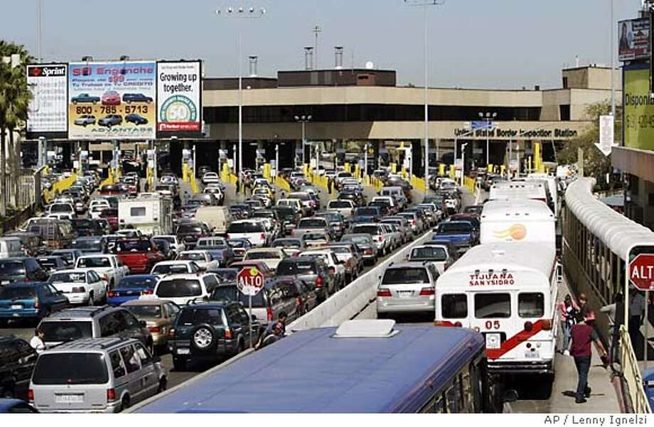 People entering the United States at border crossings like this one in San Diego will need passports in a few years. Those coming into the country by air will be required to carry passports starting in January. Associated Press photo, 2005, by Lenny Ignelzi