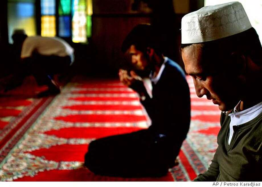 Muslim immigrants who live in Cyprus pray to celebrate Eid Al-Fitr marking the end of the holy fasting month of Ramadan in Omeriye mosque, until the 16th century known medieval Augustinian monastery of St. Marie, in divided capital Nicosia, Cyprus, Monday, Oct. 23, 2006. The three-day Eid Al-Fitr festival marks the end of the Muslim holy month of Ramadan. (AP Photo/Petros Karadjias) Photo: PETROS KARADJIAS
