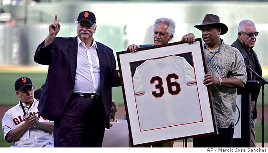 Former San Francisco Giants player Gaylord Perry, second from left, is joined by former teammates Mike McCormick, center, and Orlando Cepeda in a ceremony retiring Perry's number before the start of a game against the Florida Marlins, Saturday, July 23, 2005, in San Francisco. (AP Photo/Marcio Jose Sanchez) Ran on: 07-24-2005  Perry Ran on: 07-24-2005  Photo caption Ran on: 07-24-2005  Photo caption Ran on: 07-24-2005  Photo caption Photo: MARCIO JOSE SANCHEZ