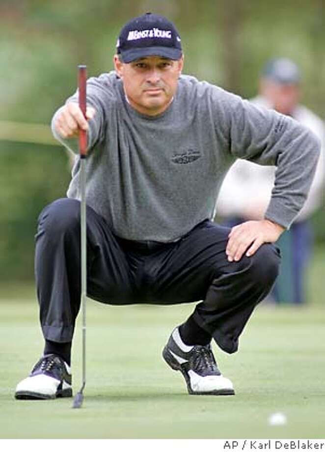 Loren Roberts stares down a putt on the 17th green during the second round of the Champions Tour's SAS Championship golf tournament, Saturday, Oct. 7, 2006, in Cary, N.C. Roberts is tied for second, one shot out of the lead. (AP Photo/Karl DeBlaker) EFE OUT Photo: KARL DEBLAKER