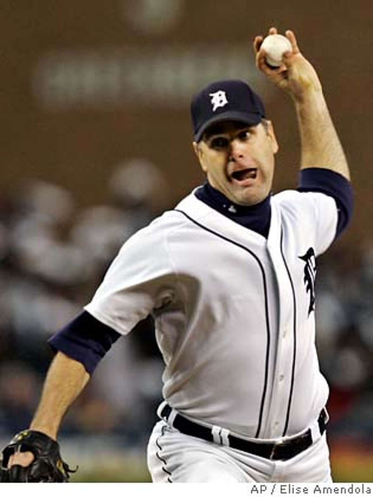 Detroit Tigers starting pitcher Kenny Rogers throws during the eighth inning in Game 3 of the American League Championship Series against the Oakland Athletics in Detroit, Friday, Oct. 13, 2006. Detroit defeated Oakland 3-0 and leads the best of seven series 3-0 games. (AP Photo/Elise Amendola)