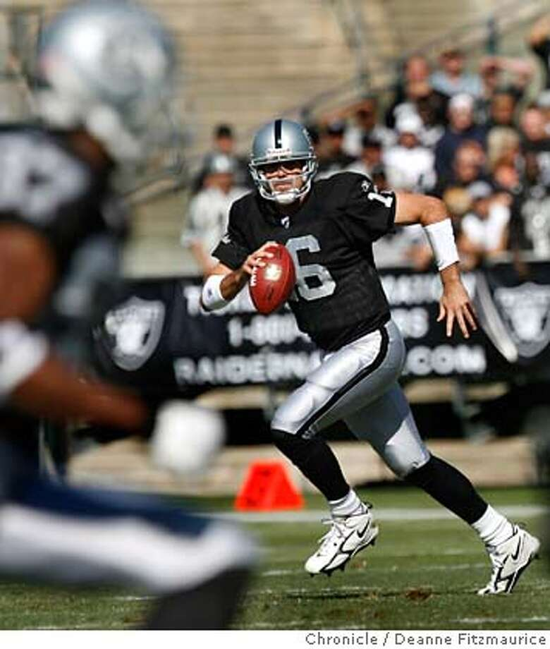 raiders_1,2_0365_df.jpg  Andrew Walter runs the ball. Oakland Raiders beat the Arizona Cardinals at McAfee Coliseum 22-9 in Oakland on 10/22/06. (Deanne Fitzmaurice/ The Chronicle) Mandatory credit for photographer and San Francisco Chronicle. /Magazines out. Photo: Deanne Fitzmaurice
