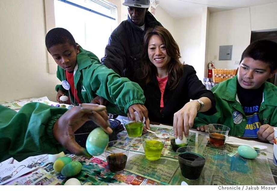 Ma_05_JMM.JPG Fiona Ma, running for the 12th Assembly District seat, paints Easter eggs, with (from left to right) Deon Mark, 13, Josef Atchan, 10, Donald Andrews, 19, and Turo Zavala, 14, at Reno's Community Barber Shop in San Francisco.  Event on 4/13/06 in SAN FRANCISCO. JAKUB MOSUR / The Chronicle MANDATORY CREDIT FOR PHOTOG AND SF CHRONICLE/ -MAGS OUT Photo: JAKUB MOSUR
