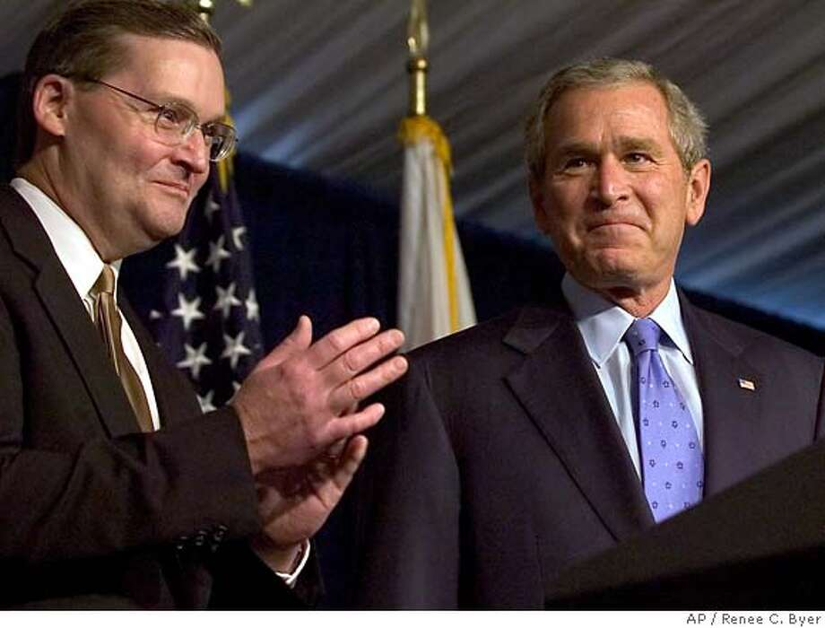 President Bush, right, is applauded by Rep. John Doolittle, R-Ca., left, during a campaign fundraiser at Serrano Country Club, Tuesday, Oct. 3, 2006 in El Dorado Hills, Calf. (AP Photo/Renee C. Byer, Pool) POOL PHOTO Photo: RENEE C. BYER