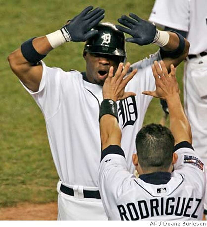 Detroit Tigers' Craig Monroe is congratulated by teammate catcher Ivan Rodriguez after Monroe's solo shot against St. Louis Cardlinals pitcher Jeff Weaver in Game 2 of the World Series on Sunday, Oct. 22, 2006 in Detroit. (AP Photo/Duane Burleson) Photo: Duane Burleson