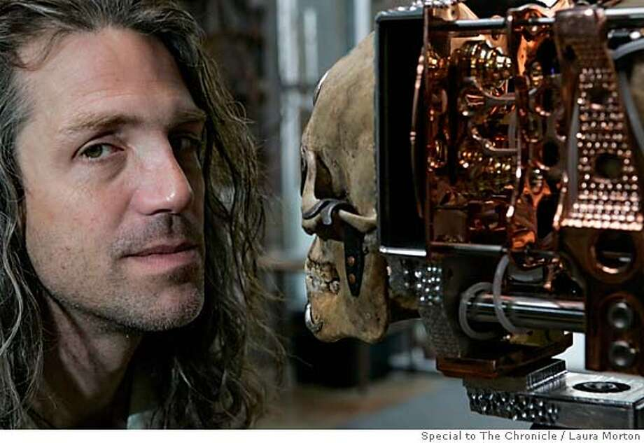"Wayne Belger poses with Yama Camera, which is made from a human skull and is one of the many pinhole camera creations on display in his exhibit ""Wayne Martin Belger: A Collection of Souls from the Borderland"" at Varnish Fine Art in San Francisco, CA. Each of the cameras Belger builds is devoted to the subject of their photographs. MANDATORY CREDIT FOR PHOTOGRAPHER AND SAN FRANCISCO CHRONICLE/ -MAGS OUT Photo: Laura Morton"
