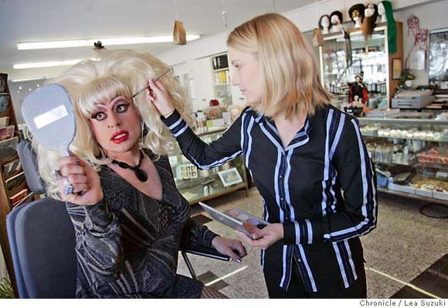 onthetown_heklina_061_ls.jpg  From left: Heklina poses in the makeup chair while Jeannette Sumner, makeup artist/retail sales at Kryolan, pretends to apply makeup.  Heklina at Kryolan on 9th street on Monday, October 9, 2006. Photo by Lea Suzuki/The San Francisco Chronicle  Photo taken on 10/9/06, in San Francisco, CA. **(themselves) cq. MANDATORY CREDIT FOR PHOTOG AND SAN FRANCISCO CHRONICLE/ -MAGS OUT Photo: Lea Suzuki