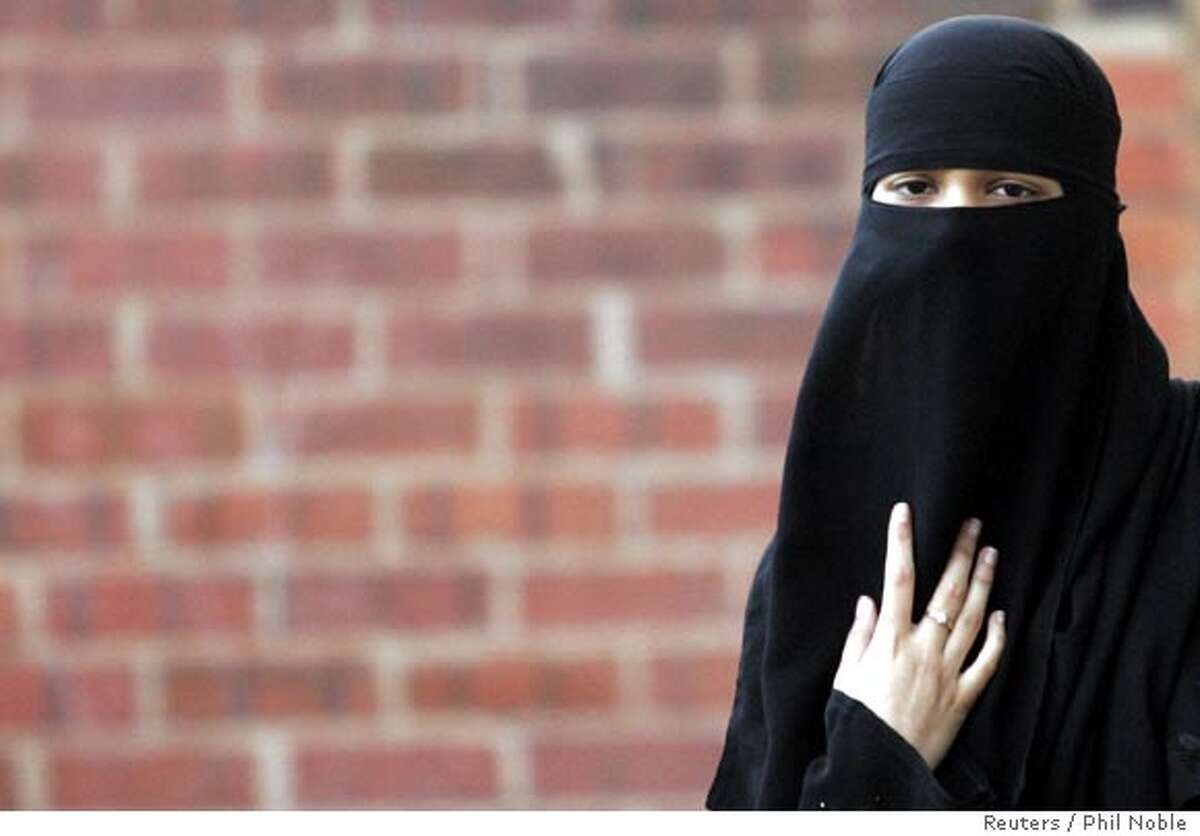 Asma Patel, a local Muslim, wears a veil known as a niqab, as she arrives for a constituency meeting with Britain's Leader of the House of Commons Jack Straw in Blackburn, northern England, October 13, 2006. Straw is meeting constituents for the first time since claiming that the facial veils of women can make community relations more difficult. REUTERS/Phil Noble (BRITAIN) Ran on: 10-18-2006 Asma Patel wears the full-face veil, or niqab, which has aroused controversy in Britain. Ran on: 10-22-2006 Young girls at a school in Beni Suef, Egypt, 150 miles south of Cairo, wear the hijab, a head scarf worn by some Muslim women.