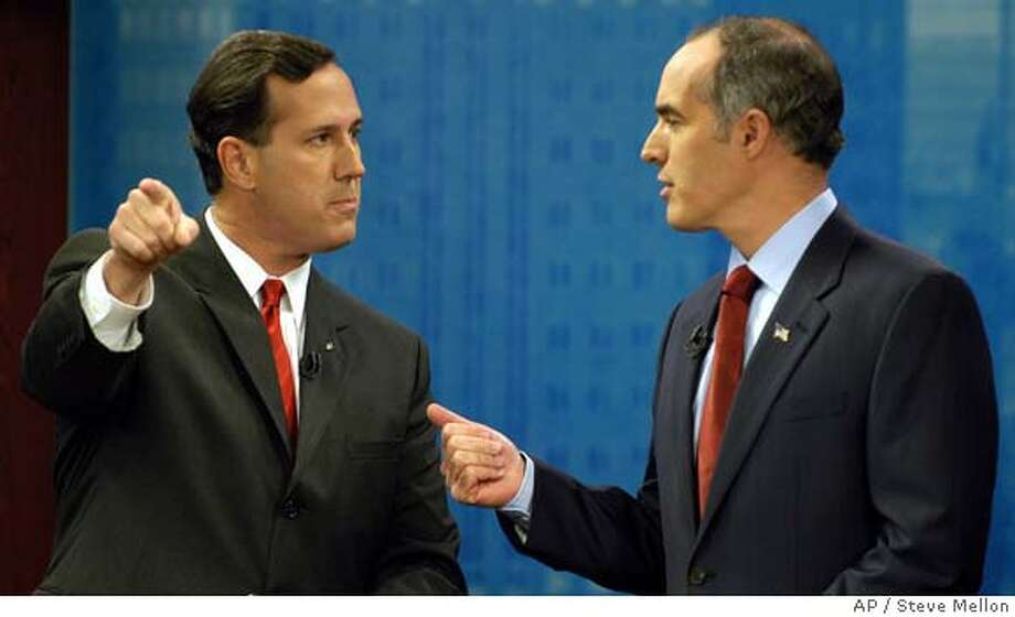 ** ADVANCE FOR MONDAY, OCT. 16 ** Sen. Rick Santorum, left, and his opponent Democrat Bob Casey confront each other during the taping of a debate at the KDKA television studio in Pittsburgh on Oct. 12, 2006. In a fresh batch of TV ads and on recent campaign stops, Santorum has sought to highlight how he and Casey disagree over how to deal with illegal immigrants in this country. (AP Photo/Steve Mellon, Pool) POOL PHOTO ADVANCE FOR MONDAY, OCT. 16 OCT. 12, 2006 PHOTO Photo: STEVE MELLON