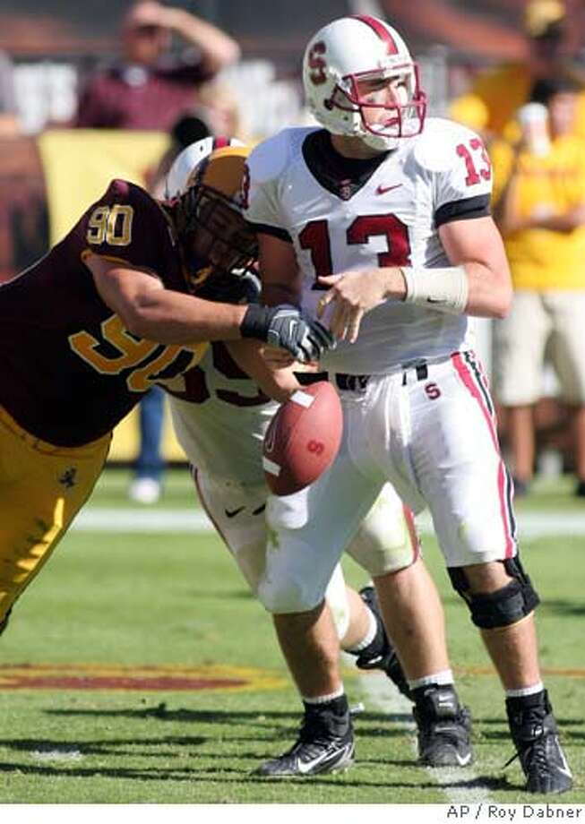 Arizona State defensive tackle David Smith (90) strips the ball away from Stanford quarterback T.C. Ostrander, during the third quarter of a college football game, Saturday, Oct. 21, 2006, in Tempe, Ariz. The ball was recovered by Arizona State's Will Kote.(AP Photo/Roy Dabner) Photo: ROY DABNER