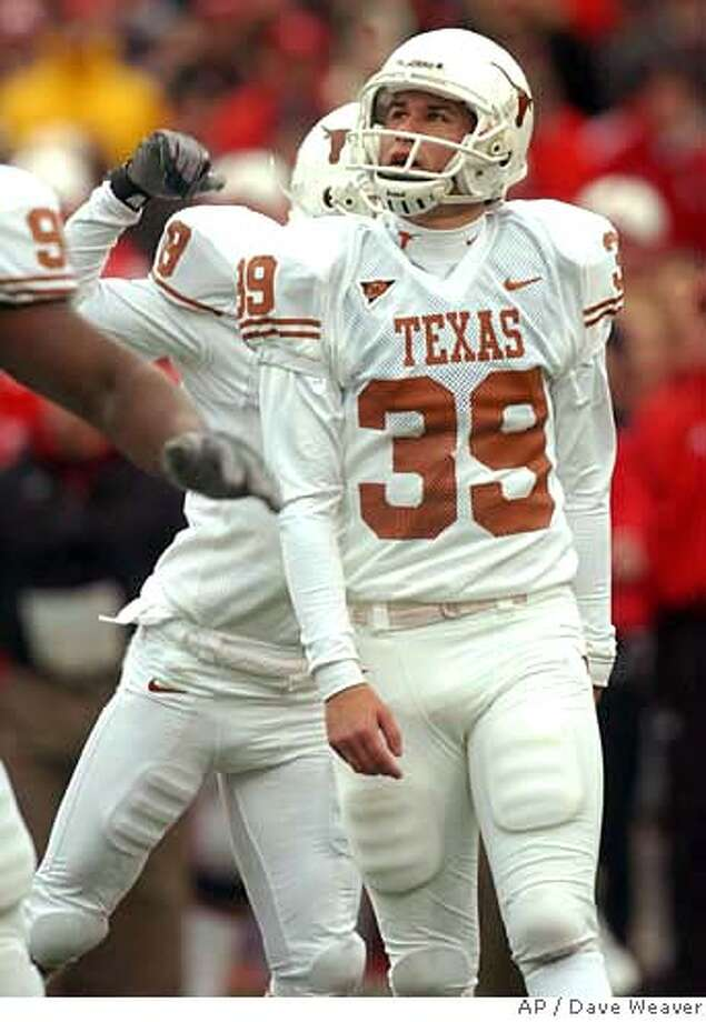 Texas's Ryan Bailey (39) watches the game-winning field goal clear the goal-posts late in the fourth quarter against Nebraska during college football action, Saturday Oct 21, 2006 in Lincoln, Neb. Bailey's first collegiate field goal beat Nebraska 22-20. (AP Photo/Dave Weaver) Photo: DAVE WEAVER